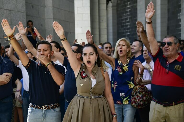 Spaniards making fascist salutes