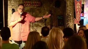 Chris Groves performing stand-up in Barcelona.
