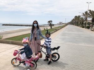 Mother with two young kids in Sitges