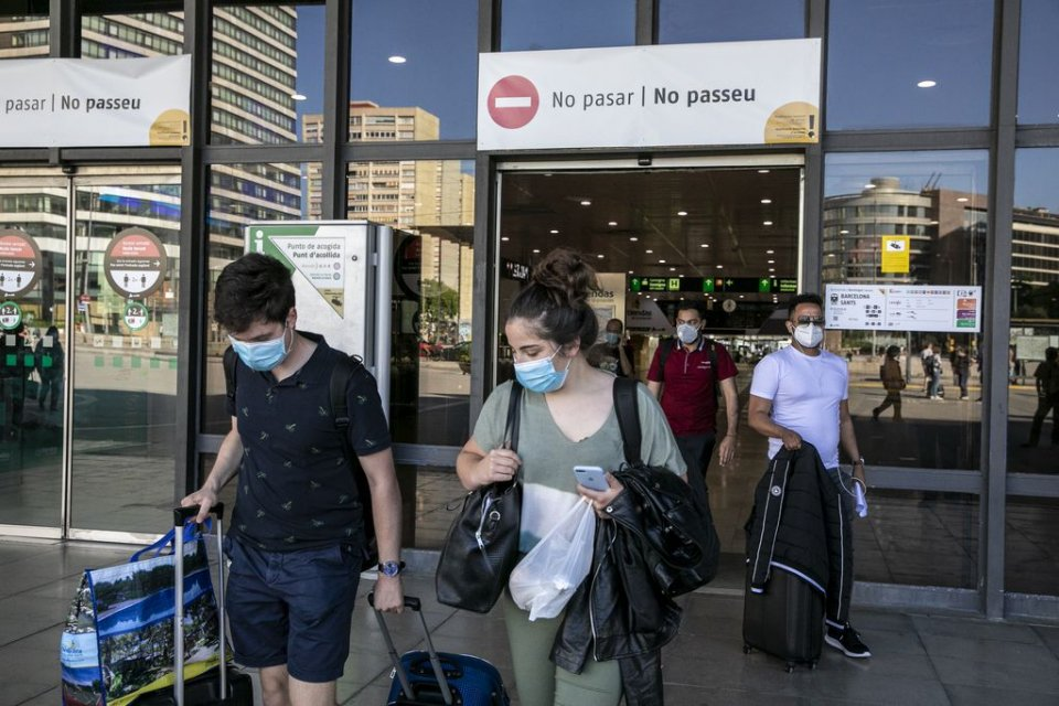 Travellers with face masks at Sants station