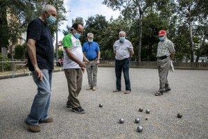 A group of men playing pétanque