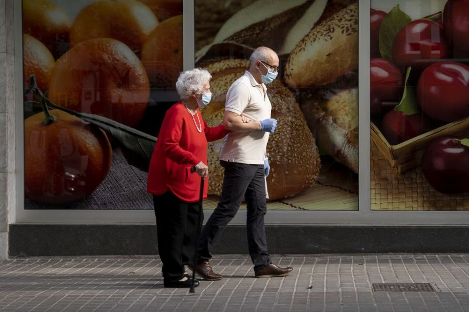 A man accompanying an elderly lady