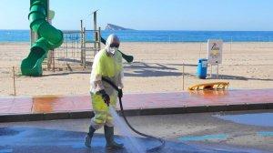 Disinfecting near Benidorm beach.