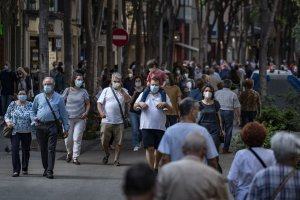 People walking with face masks in Catalonia