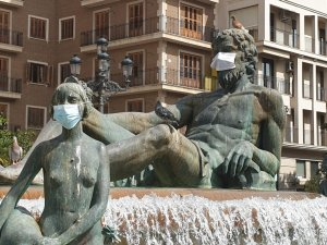 Face masks on statues in Valencia.