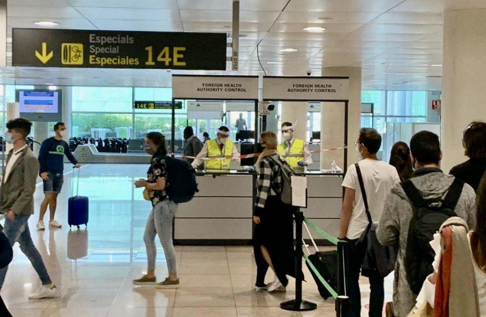 Travellers arriving Spain