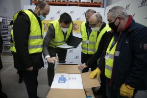 Personnel working on the distribution of the first batches of vaccines that arrived in Spain