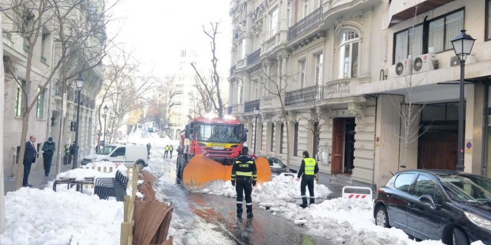Personnel from Spain's Unidad Militar de Emergencias (UME) helping to clear streets in Madrid