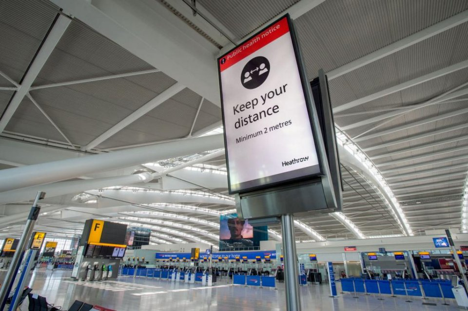 Social distancing signs for passengers at Heathrow, London. (Heathrow Airport)