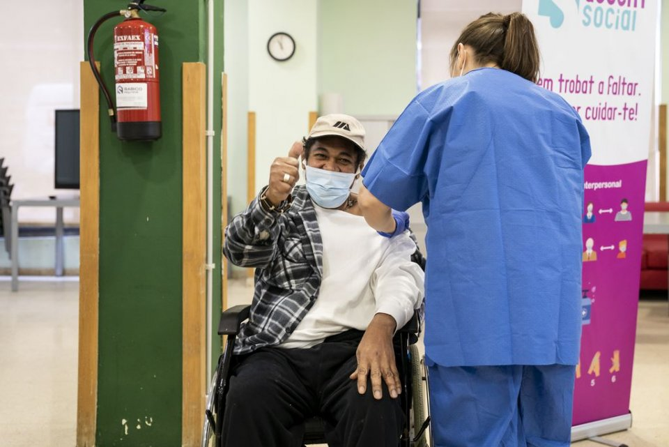 A man giving the thumbs up whilst receiving a jab of the Covid-19 vaccine in Barcelona