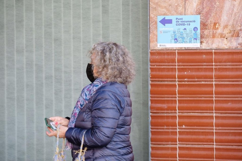 A woman heading to receive a jab of the Covid-19 vaccine in Barcelona