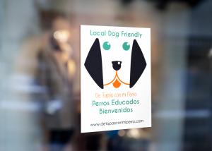 A 'DoggieSnax' sticker for a dog friendly establishment.