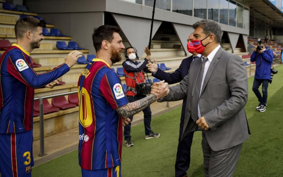 Joan Laporta greeting Lionel Messi