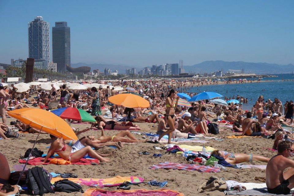 People sunbathing on Barceloneta beach in Barcelona in 2019