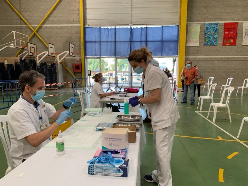 Health workers preparing to administer vaccinations in Catalonia