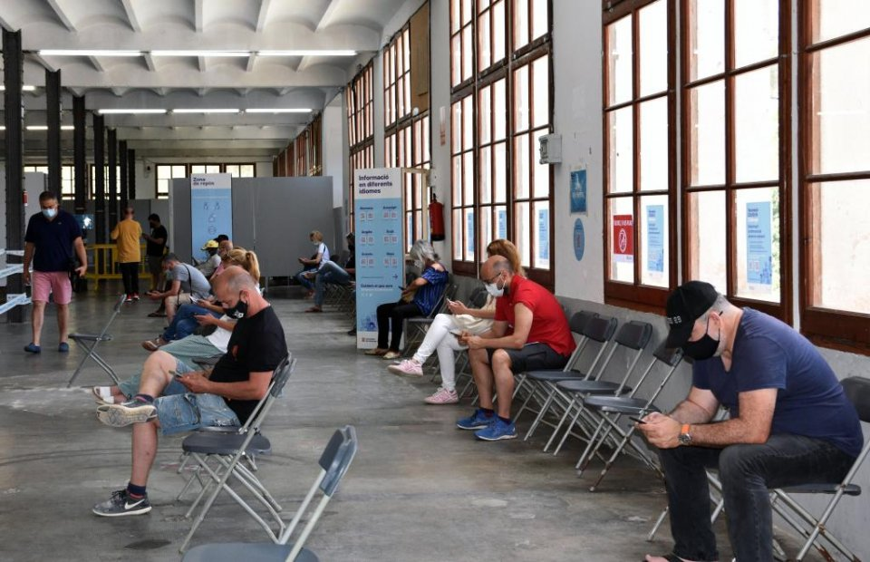 Citizens waiting for vaccinations at the Llobet-Guri Factory in Calella, in Alt Maresme, Catalonia