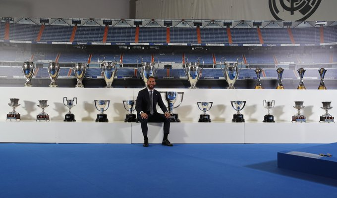 Sergio Ramos with Real Madrid's trophies.
