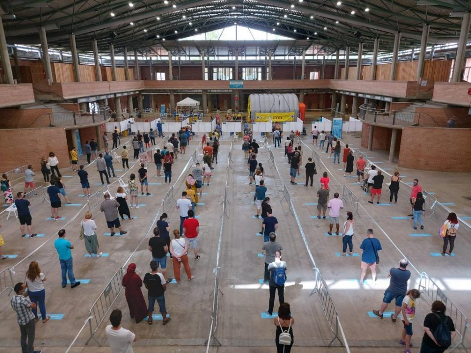 Citizens queuing to receive vaccination jabs in Girona, Catalonia