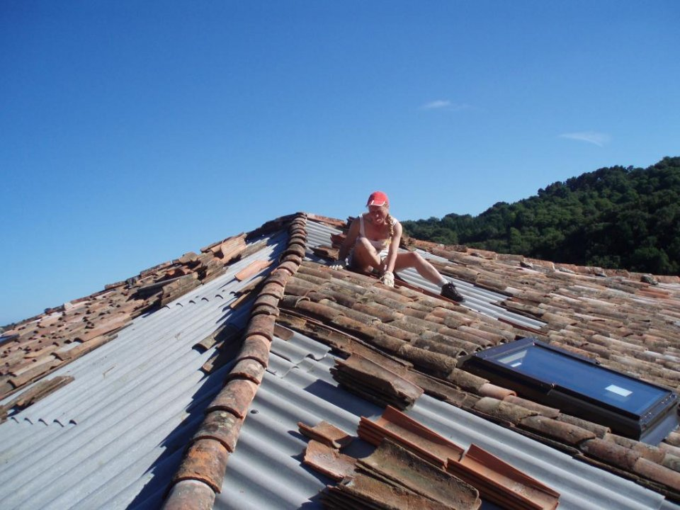 Tiling the roof. (Lisa Rose Wright)
