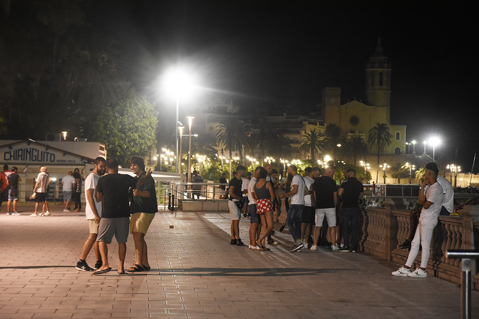 Young people on La Ribera seafront in Sitges