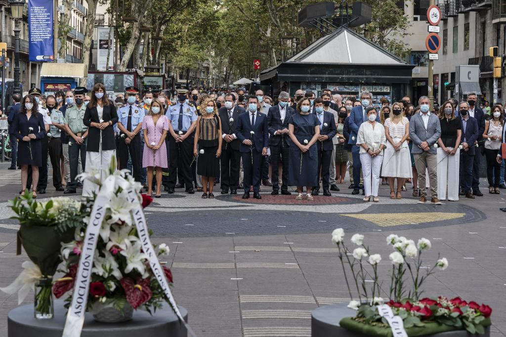 Catalan president Pere Aragonès and the mayor of Barcelona, Ada Colau, together with other politicians and dignitaries, paying tribute to victims on the fourth anniversary of the Barcelona terror attack in La Rambla on 17 August 2021.