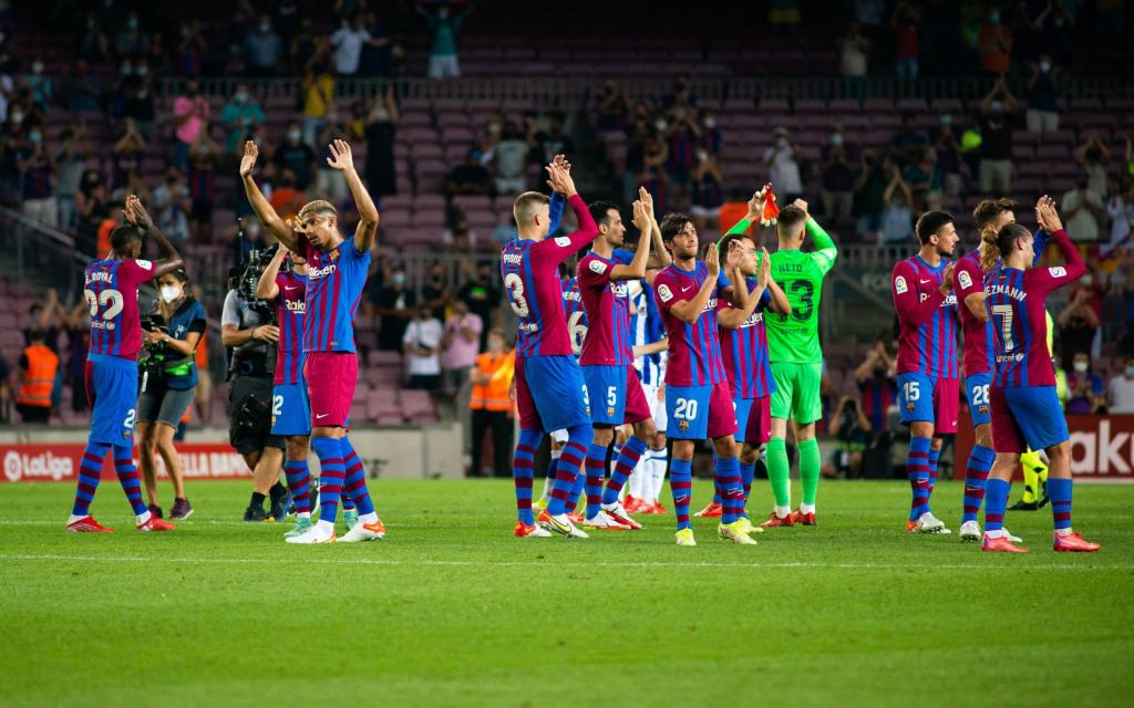 Barça players celebrating their victory over Real Sociedad.