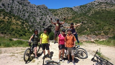 A group above the Cueva del Gato / Hike + Bike