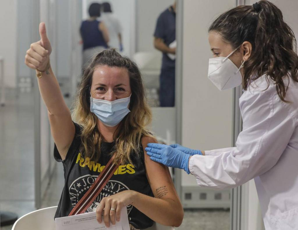 A woman giving the thumb up after receiving a vaccination in Valencia.