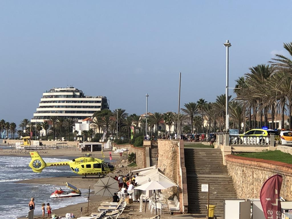 The helicopter on the beach and the ambulances on the promenade in Sitges